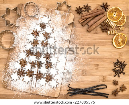 christmas cookie cinnamon stars and spices on wooden background. vanilla pods, cloves, star anise and cinnamon - stock photo