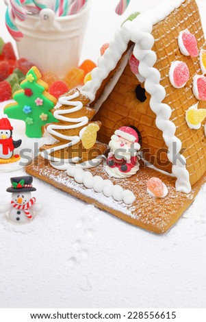 Christmas cookie house with festive decoration  - stock photo