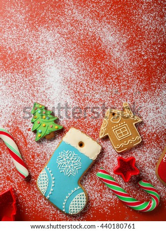 christmas cookies and candys on red background, holiday food - stock photo