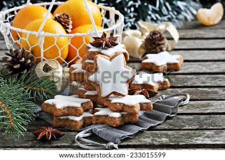 Christmas cookies and decoration on a rustic wooden table.Selective focus. - stock photo