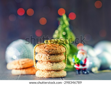 christmas cookies and decoration on the wooden table - stock photo