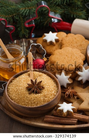 Christmas cookies and ingredients for baking, vertical, close-up