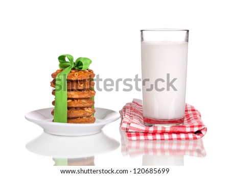 christmas cookies and milk for santa claus on white background - stock photo