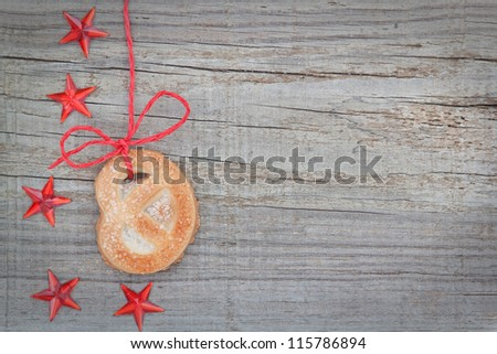Christmas cookies and star on the tape. On textured wood.