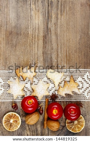 Christmas cookies, apples and nuts on wooden table. Copy space - stock photo