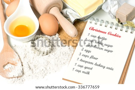 Christmas cookies baking ingredients eggs, flour, sugar, butter, yeast. Food background. Sample text Recipe - stock photo