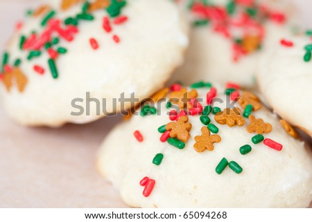 Christmas cookies decorated with festive sprinkles. - stock photo