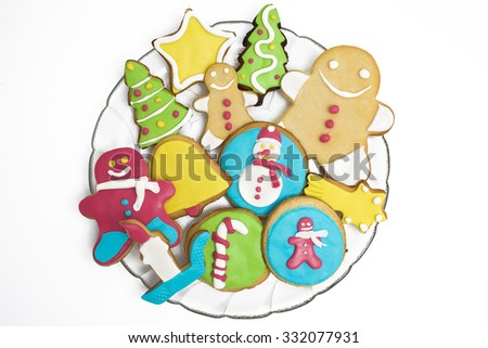 Christmas cookies decorated with fondant on white background - stock photo