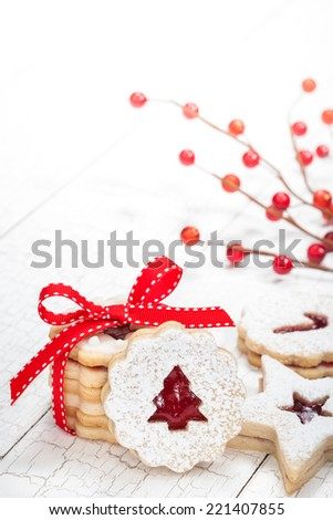 Christmas cookies decorated with powdered sugar - stock photo