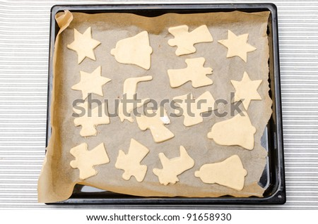 Christmas cookies dough ready to be put in the oven - stock photo