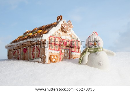 Christmas cookies house in snow (oneself made cookies house) - stock photo