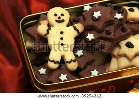 Christmas cookies in a box on red fabric - stock photo