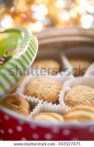 Christmas cookies in a box with a background Christmas lights - stock photo