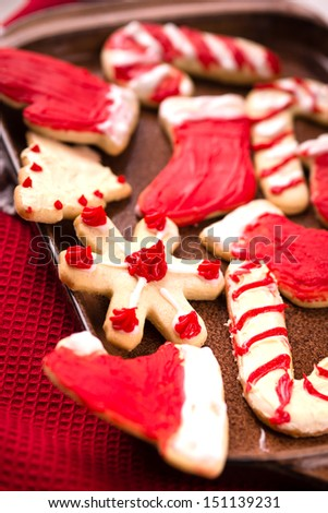 Christmas cookies in different shapes with frosting - stock photo