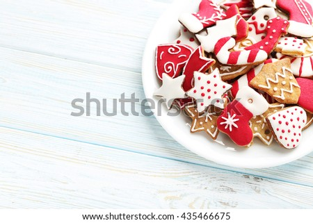 Christmas cookies in plate on a blue wooden table - stock photo
