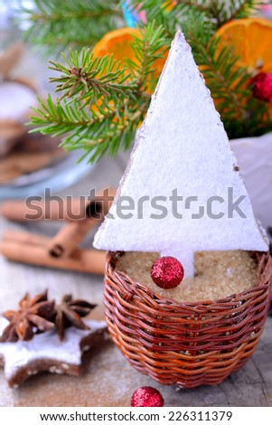 Christmas cookies in the shape of a tree on a wooden background. selective Focus - stock photo
