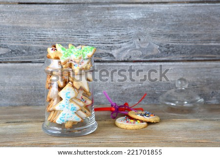 Christmas cookies in the shape of pine on jar, tasty food - stock photo
