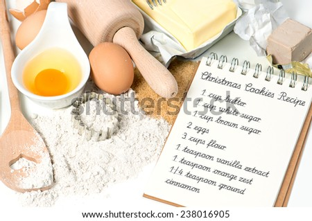 Christmas cookies ingredients eggs, flour, sugar, butter, yeast. Recipe book with sample text - stock photo