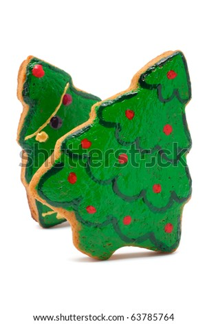 Christmas cookies made in the shape of a Christmas tree. Isolated on white background.