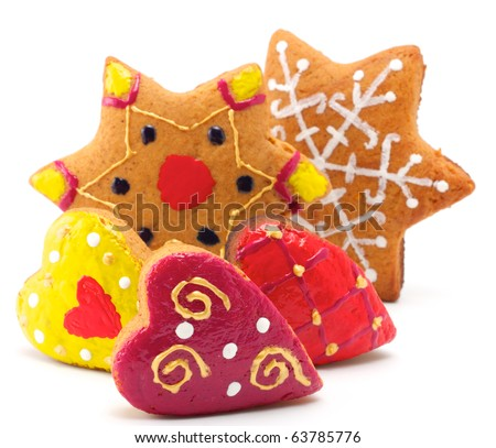 Christmas cookies of different shapes. All cookies are colored differently. Isolated on white background.