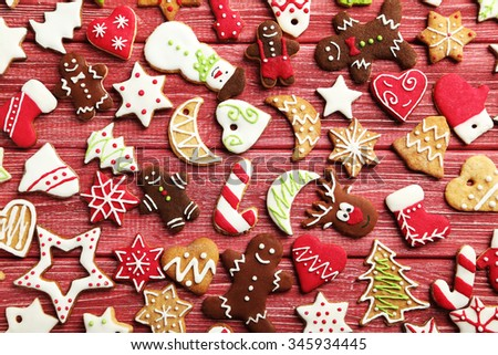 Christmas cookies on a red wooden table - stock photo