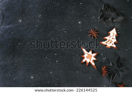 Christmas cookies on black stone background. Top view. - stock photo