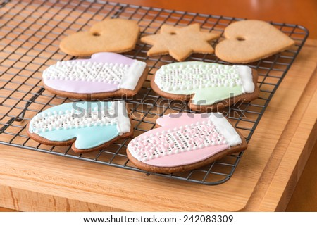 Christmas cookies on cooling rack. Selective focus, shallow dof - stock photo