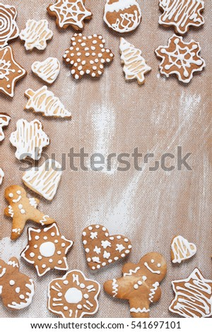 Christmas cookies on plywood background with copyspace in the right