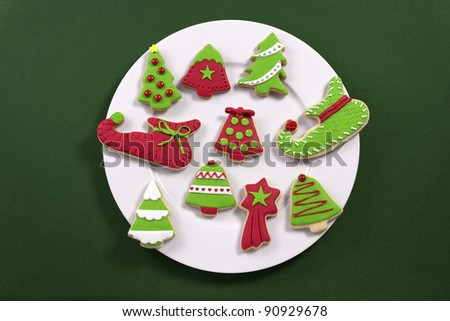 Christmas cookies on white plate - stock photo