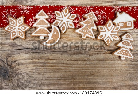Christmas cookies on wooden background. Copy space, blank board for your text