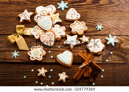 Christmas cookies on wooden background. Top view. Selective focus - stock photo