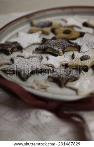 Christmas cookies sprinkled by icing sugar - stock photo