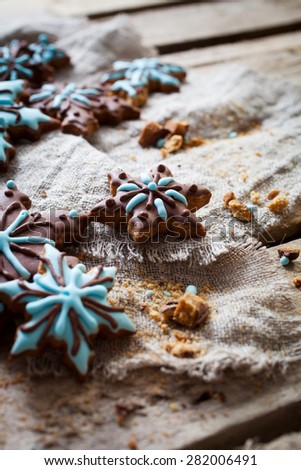 Christmas cookies with brown and blue frosting - stock photo