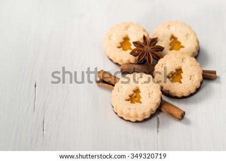 Christmas cookies with christmas tree, cinnamon and anise - stock photo