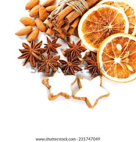 christmas cookies with cinnamon sticks, anise stars and sliced of dried orange - stock photo