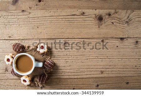 Christmas cookies with coffee over wooden background, Christmas background. - stock photo