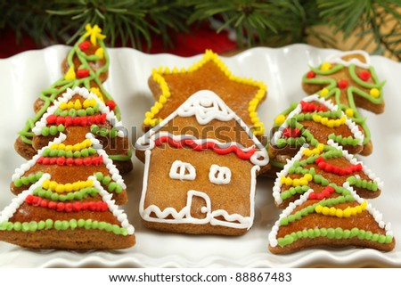 Christmas cookies with colorful sweet decoration - stock photo