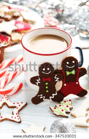 Christmas cookies with cup of hot coffee on a blue wooden table