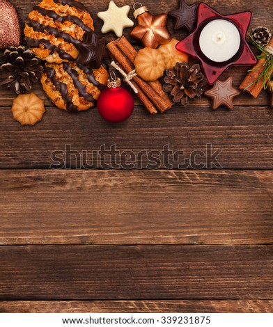 Christmas cookies with fir tree branches, balls and festive decor on the old wood background  - stock photo
