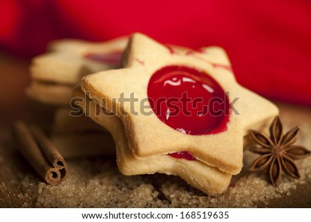 Christmas cookies with spices on a wooden background. - stock photo