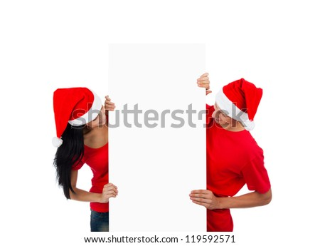 Christmas couple hold white board with empty copy space, concept of advertise new year season shopping sale, wear red hats and shirts, isolated over white background