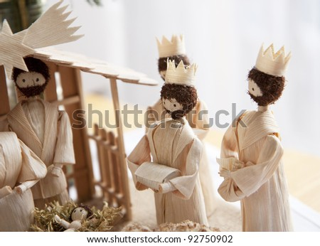 Christmas crib and three wise men giving gifts to Jesus baby