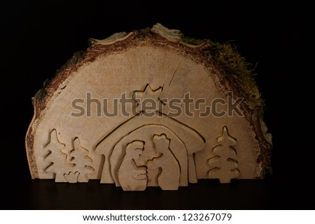 christmas crib cut out of a birch tree. nativity scene. holy family. Jesus Christ, Mary and Josef and three kings - stock photo