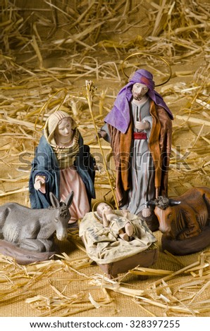 Christmas Crib. Figures of Baby Jesus, Virgin Mary and St. Joseph