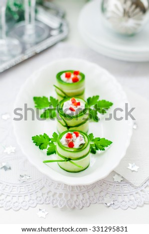 Christmas Cucumber Rolls Stuffed with Feta, Herbs, Capsicum and Black Olives, copy space for your text - stock photo