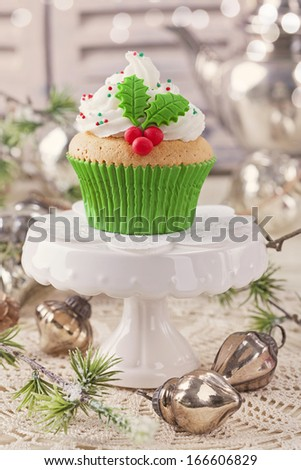 Christmas cup cake with holly berry