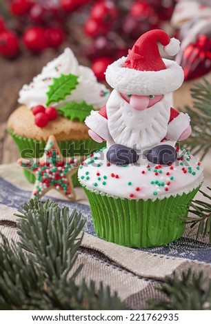 Christmas cup cakes and candy canes - stock photo