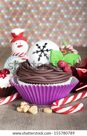 Christmas cupcake with bell, candy canes and snowman - stock photo