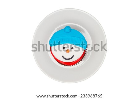 Christmas cupcake with butter cream icing. Snowman - stock photo