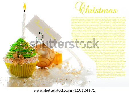 Christmas cupcake with decoration and merry christmas label on white background. - stock photo